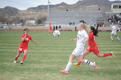 Pueblo Centennial's Gia Palumbo, left, and Dani Bordenave and Tigers senior Nicole Decker converge on the ball during overtime on Saturday at Citizens' Stadium. The Tigers and Bulldogs tied 2-2. Brandon Hopper/Daily Record