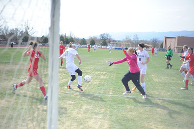 Tigers junior Amy Solis scores the game-tying goal against Pueblo Centennial on Saturday at Citizens' Stadium. The Tigers and Bulldogs tied 2-2. Brandon Hopper/Daily Record
