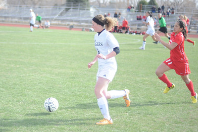 Tigers senior Nacole Miller dribbles against Pueblo Centennial on Saturday at Citizens' Stadium. The Tigers and Bulldogs tied 2-2. Brandon Hopper/Daily Record
