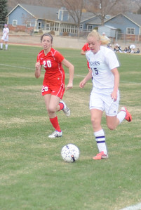 Tigers senior Nicole Decker dribbles up the field against Pueblo Centennial on Saturday at Citizens' Stadium. The Tigers and Bulldogs tied 2-2. Brandon Hopper/Daily Record