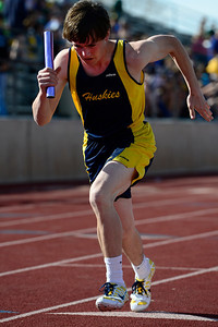 Florence trackster Jared Ferguson takes off on his leg of the 4x200 relay Friday at the blossom track meet at Citizens' Stadium. Jeff Shane/ Daily Record