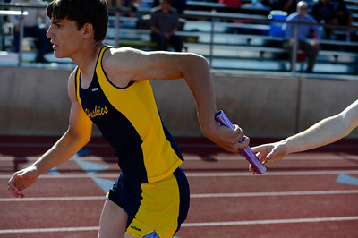 Florence trackster Jared Bombardier takes a handoff on his leg of the 4x200 relay Friday at the blossom track meet at Citizens' Stadium. Jeff Shane/ Daily Record