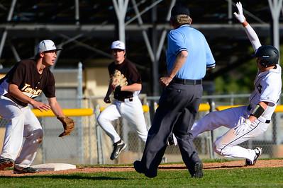 Tigers senior Logan Hilburn, right, slides into third base against Palmer Thursday at Justin Field. Jeff Shane/ Daily Record