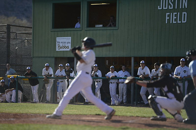 The Tiger's dugout watches blake Madone at bat against Palmer Thursday at Justin Field. Jeff Shane/ Daily Record