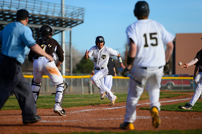 Tigers senior RJ Stainbrook, center, makes a run for home against Palmer Thursday at Justin Field. Jeff Shane/ Daily Record