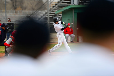 Tigers sophomore Jared Mews takes a swing against Pueblo Centennial at Justin Field. Jeff Shane/ Daily Record