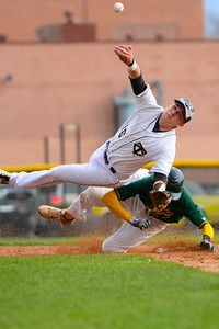 Tigers junior Logan Nethercot, top, gets upset against Pueblo County Monday at Justin Field. Jeff Shane/ Daily Record