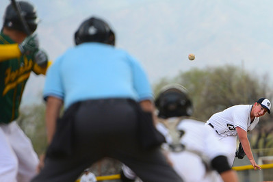 Tigers senior Michael Kear delivers against Pueblo County Monday at Justin Field. Jeff Shane/ Daily Record