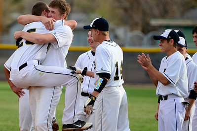 Tigers players celebrate after beating Pueblo County Monday at Justin Field. Jeff Shane/ Daily Record