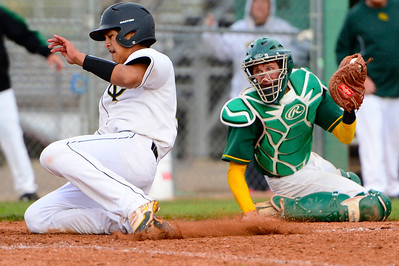 Tigers senior RJ Stainbrook, left, slides into home plate against Pueblo County Monday at Justin Field. Jeff Shane/ Daily Record