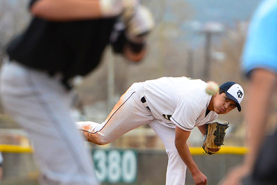 Tigers senior RJ Stainbrook delivers against Pueblo South Thursday at Justin Field. Jeff Shane/ Daily Record