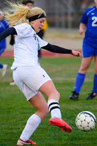 Tigers senior Nicole Decker passes the ball Monday against Pueblo Central. Jeff Shane/ Daily Record