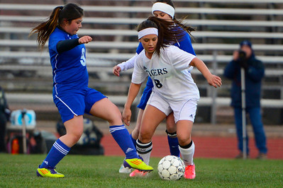 Tigers senior Moriah Archuleta, right, makes a move Monday against Pueblo Central. Jeff Shane/ Daily Record