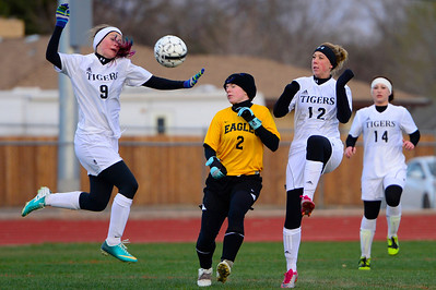 Tigers freshman Whitney Boehm , left, and senior Ashley Cross chase a ball against Pueblo East's Leah Collier Wednesday at Citizens' Stadium. Jeff Shane/ Daily Record