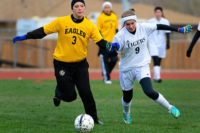 Tigers freshman Whitney Boehm , right, chases a ball against Pueblo East's Paulina Morales Wednesday at Citizens' Stadium. Jeff Shane/ Daily Record
