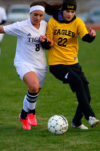 Tigers senior Moriah Archuleta, left, battles for a ball against Pueblo East's Emily Waggener Wednesday at Citizens' Stadium. Jeff Shane/ Daily Record