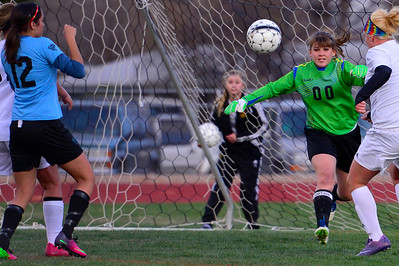 Tigers senior keeper Emily Holt hustles for a ball Friday against Pueblo West at Citizens' Stadium. Jeff Shane/ Daily Record