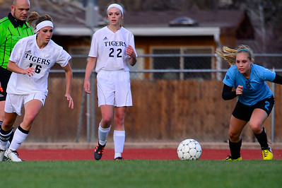 Tigers senior Emily Hoffman, left, challenges Pueblo West's Bailee Jameson for the ball Friday at Citizens' Stadium. Jeff Shane/ Daily Record