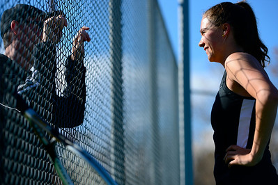Tigers junior Erika O'Rourke talks to head coach Dan Heath during her match against Air Academy Wednesday at Rudd Park. Jeff Shane/ Daily Record