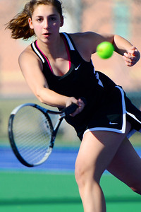 Tigers senior Josie Carochi chases a ball against Air Academy Wednesday at Rudd Park. Jeff Shane/ Daily Record