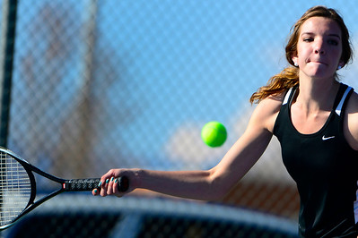 Tigers senior Nicole Berger returns a ball against Air Academy Wednesday at Rudd Park. Jeff Shane/ Daily Record
