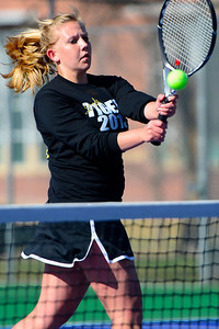 Tigers senior Kacey Ruona returns a ball against Air Academy Wednesday at Rudd Park. Jeff Shane/ Daily Record