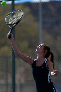 Tigers senior Brianna Lloyd returns a ball Thursday against Pueblo County at Rudd Park. Jeff Shane/ Daily Record