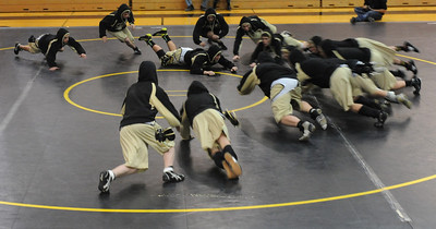 Tigers wrestlers dive into the middle while warming up before their dual against Pueblo South on Thursday, Jan. 17, 2013. Brandon Hopper/Daily Record