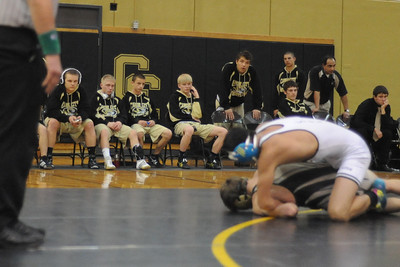 The Canon City bench watches during the Tigers' dual against Pueblo South on Thursday, Jan. 17, 2013. Brandon Hopper/Daily Record