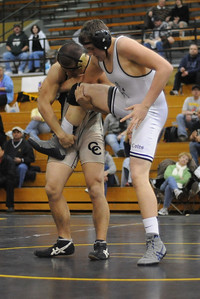 Tommy Dexter puts a move on Jacob Mihelich during the Tigers' dual against Pueblo South on Thursday, Jan. 17, 2013. Brandon Hopper/Daily Record