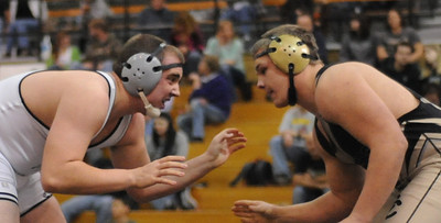 Hunter Reinert, left, and Garrett Benell during the Tigers' dual against Pueblo South on Thursday, Jan. 17, 2013. Brandon Hopper/Daily Record