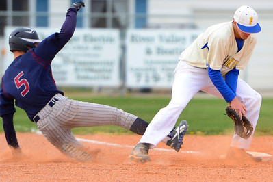 Huskies junior Dennis Donley, right, tries to make a play at first base against TCA Tuesday at Babitz Field. Jeff Shane/ Daily Record