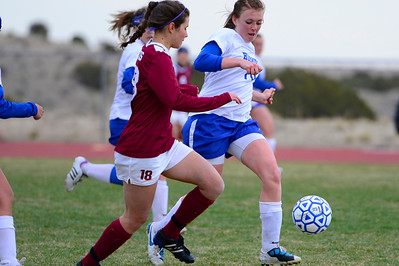 Huskies senior Kenzie Gordon, right, goes after a ball against TCA Wednesday in Florence. Jeff Shane/ Daily Record