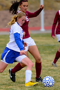 Huskies junior Megan Droll, left, makes a move against TCA Wednesday in Florence. Jeff Shane/ Daily Record