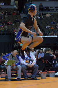 Dillon Bellino warms up before his first-round match on Thursday at the state wrestling tournament at Pepsi Center in Denver. Domenic Naro/Special to the Daily Record