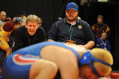 Bob Masse yells to Conner Ward on Thursday at the Class 3A state wrestling tournament at Pepsi Center in Denver. Brandon Hopper/Daily Record
