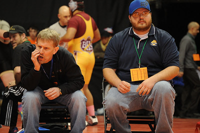Huskies coach Bob Masse, left, yells during Conner Ward's match on Thursday at the Class 3A state wrestling tournament at Pepsi Center in Denver. Brandon Hopper/Daily Record