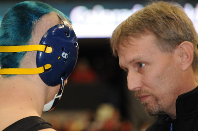 Huskies coach Bob Masse talks with Dillon Bellino before his second-round consolation match on Friday during the Class 3A state wrestling tournament at Pepsi Center in Denver. Brandon Hopper/Daily Record