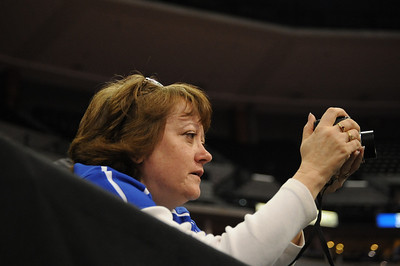 Jacob Yslas' mother cheers after her son won his conslation first-round matches on Friday at the Class 3A state tournament at Pepsi Center in Denver. Brandon Hopper/Daily Record