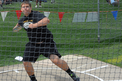 Tigers sophomore Austin Brant throws during the discus event on Saturday at the Class 4A state track and field meet at Jeffco Stadium in Lakewood. Brandon Hopper/Daily Record