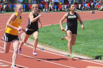 Canon City Tigers senior Christine Conley, middle, runs in the 400-meter race at the Class 4A state track and field meet at Jeffco Stadium in Lakewood on Thursday. Brandon Hopper/Daily Record