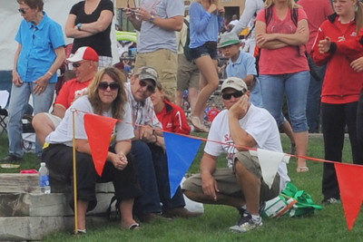 Makenna Green's family and coach Tom Torres watch her make her final throws on Saturday. Brandon Hopper/Daily Record