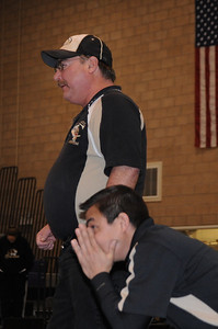 Tigers coaches Duff Seaney, top, and Erik Ortega look on during Garrett Benell's in the Class 4A Region 1 tournament at Discovery Canyon High School on Saturday. Brandon Hopper/Daily Record