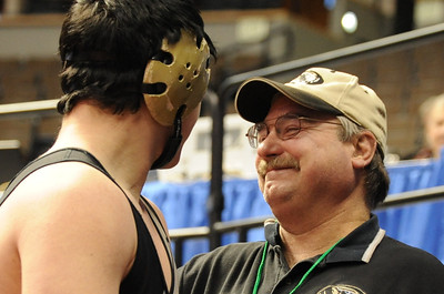 Tigers coach Duff Seaney smiles as Garrett Benell walks off the mat on Thursday at the Class 4A state wrestling tournament at Pepsi Center in Denver. Brandon Hopper/Daily Record