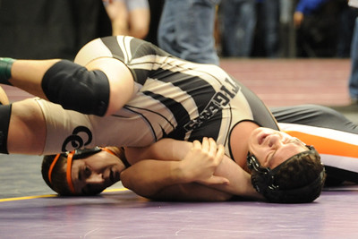 Anthony Abbott works out of getting pinned on Thursday at the Class 4A state wrestling tournament at Pepsi Center in Denver. Brandon Hopper/Daily Record