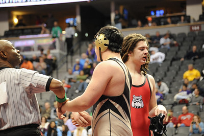 The official raises Garrett Benell's hand as Brock Howe walks off the mat on Thursday at the Class 4A state wrestling tournament at Pepsi Center in Denver. Brandon Hopper/Daily Record
