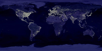 NASA NIGHT PHOTOS This image of Earth's city lights was created with data from the Defense Meteorological Satellite Program (DMSP) Operational Linescan System (OLS). Originally designed to view clouds by moonlight, the OLS is also used to map the locations of permanent lights on the Earth's surface. The brightest areas of the Earth are the most urbanized, but not necessarily the most populated. (Compare western Europe with China and India.) Cities tend to grow along coastlines and transportation networks. Even without the underlying map, the outlines of many continents would still be visible. The United States interstate highway system appears as a lattice connecting the brighter dots of city centers. In Russia, the Trans-Siberian railroad is a thin line stretching from Moscow through the center of Asia to Vladivostok. The Nile River, from the Aswan Dam to the Mediterranean Sea, is another bright thread through an otherwise dark region. Even more than 100 years after the invention of the electric light, some regions remain thinly populated and unlit. Antarctica is entirely dark. The interior jungles of Africa and South America are mostly dark, but lights are beginning to appear there. Deserts in Africa, Arabia, Australia, Mongolia, and the United States are poorly lit as well (except along the coast), along with the boreal forests of Canada and Russia, and the great mountains of the Himalaya.