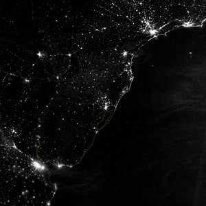 "NASA NIGHT PHOTOS This image of part of the Atlantic coast of South America was acquired by the Suomi NPP satellite on the night of July 20, 2012. The image was made possible by the ""day-night band"" of the Visible Infrared Imaging Radiometer Suite (VIIRS), which detects light in a range of wavelengths from green to near-infrared and uses filtering techniques to observe dim signals such as city lights, gas flares, auroras, wildfires, and reflected moonlight."