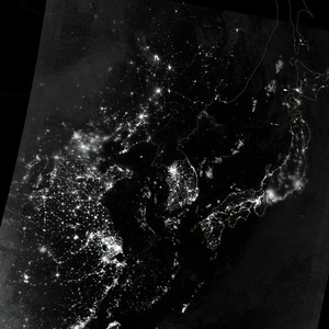 NASA NIGHT PHOTOS City lights at night are a fairly reliable indicator of where people live. But this isn't always the case, and the Korean Peninsula shows why. As of July 2012, South Korea's population was estimated at roughly 49 million people, and North Korea's population was estimated at about half that number. But where South Korea is gleaming with city lights, North Korea has hardly any lights at all—just a faint glimmer around Pyongyang.