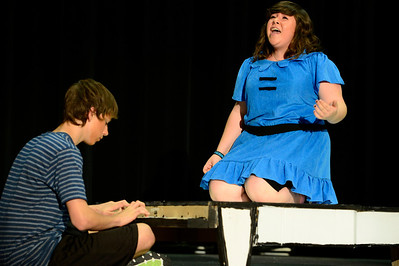 "Florence High School actors Noah Torres, left, and Erin Espinosa rehearse a scene from their upcoming play ""You're a Good Man, Charlie Brown"" Tuesday at the school. Jeff Shane/ Daily Record"